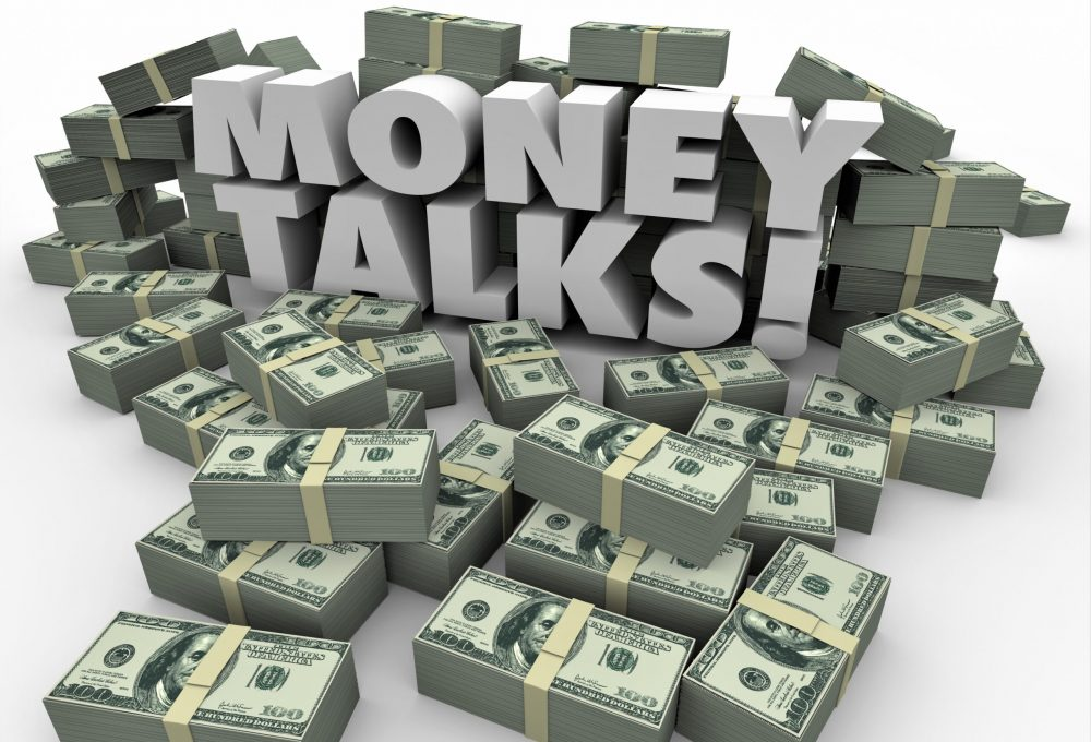 Money,Talks,Words,In,White,3d,Letters,Surrounded,By,Staks